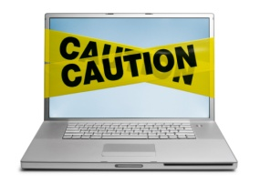 caution laptop with virus or malware